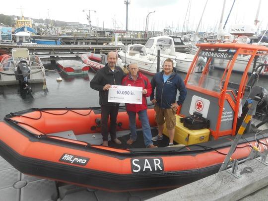 OK uddeler skulderklap og donation til Dansk Søredningsselskab